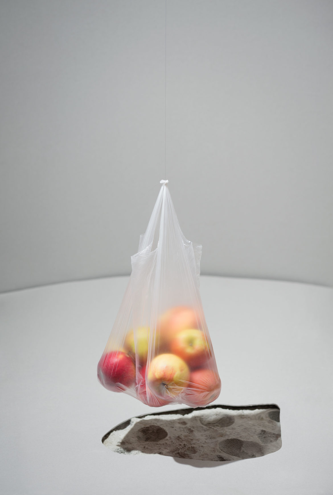 "Sigrid Viir ""Polish"" from three-part photo installation ""Snapshot photos of the Moon, black holes filled with sugar cube, snowball as a noble gift, Polish apple in a lift"" , 2016"